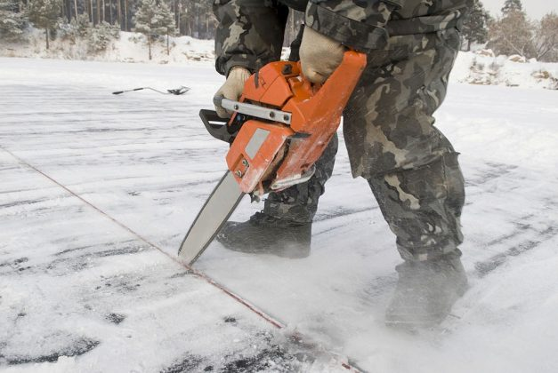 cutting ice with a chainsaw